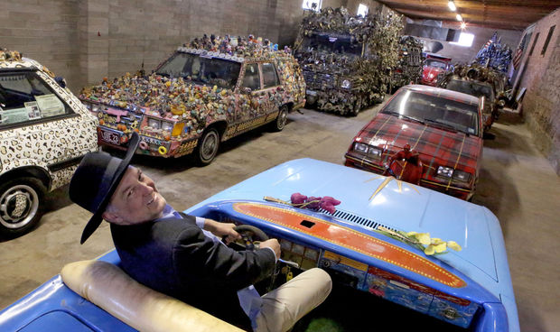 Documentary filmmaker and artist Harrod Blank sits in a car named after Miss Vicky, the first wife of entertainer Tiny Tim, inside his unfinished museum, Art Car World, which inhabits the old Nelson's Glass building in Douglas.